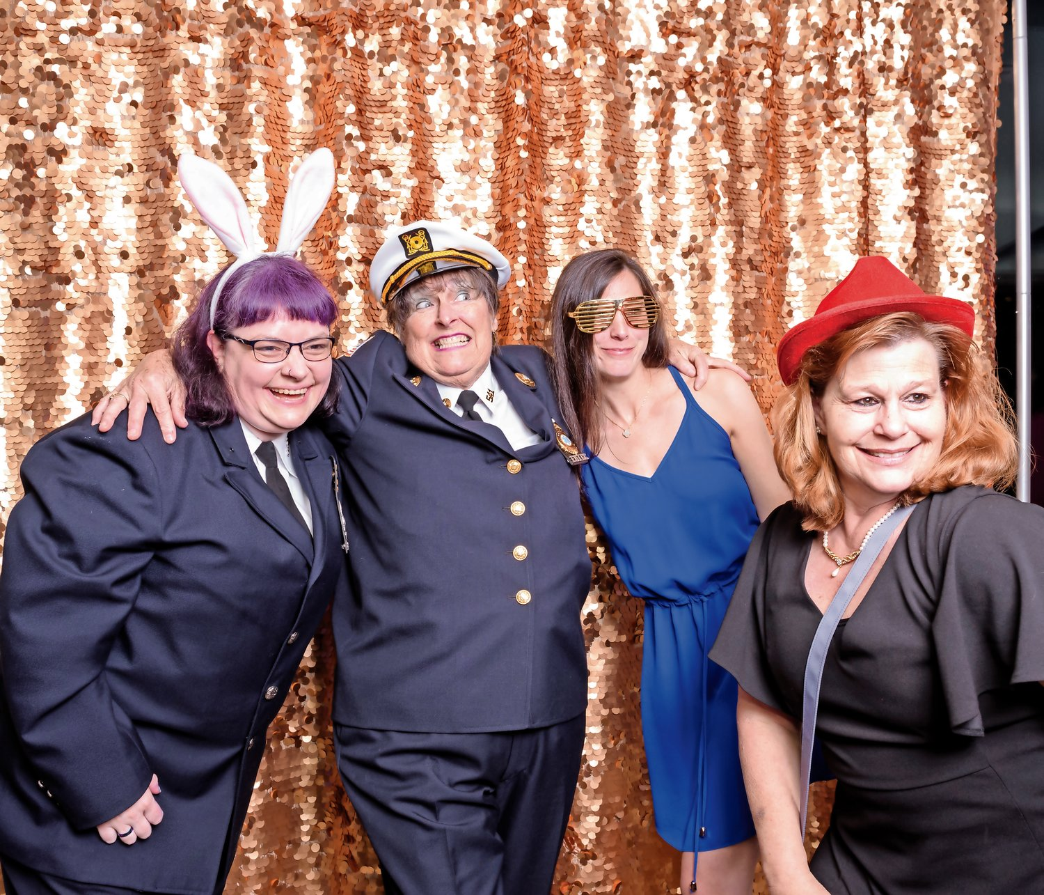 Meri Kassner, left, Lynn Ramskill, Sara Berke and Tori Savinetti accessorized to the nines before entering the photo booth at the Locust Valley Fire Department installation dinner on May 11.