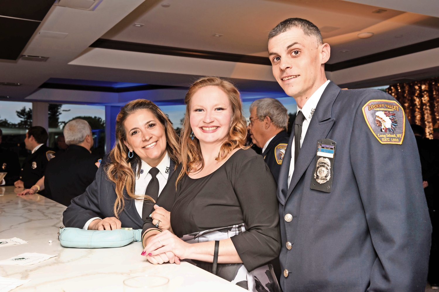EMT Lisa Constantin, left, Kelly Moore and Sean Coanpet cozied up to the bar.