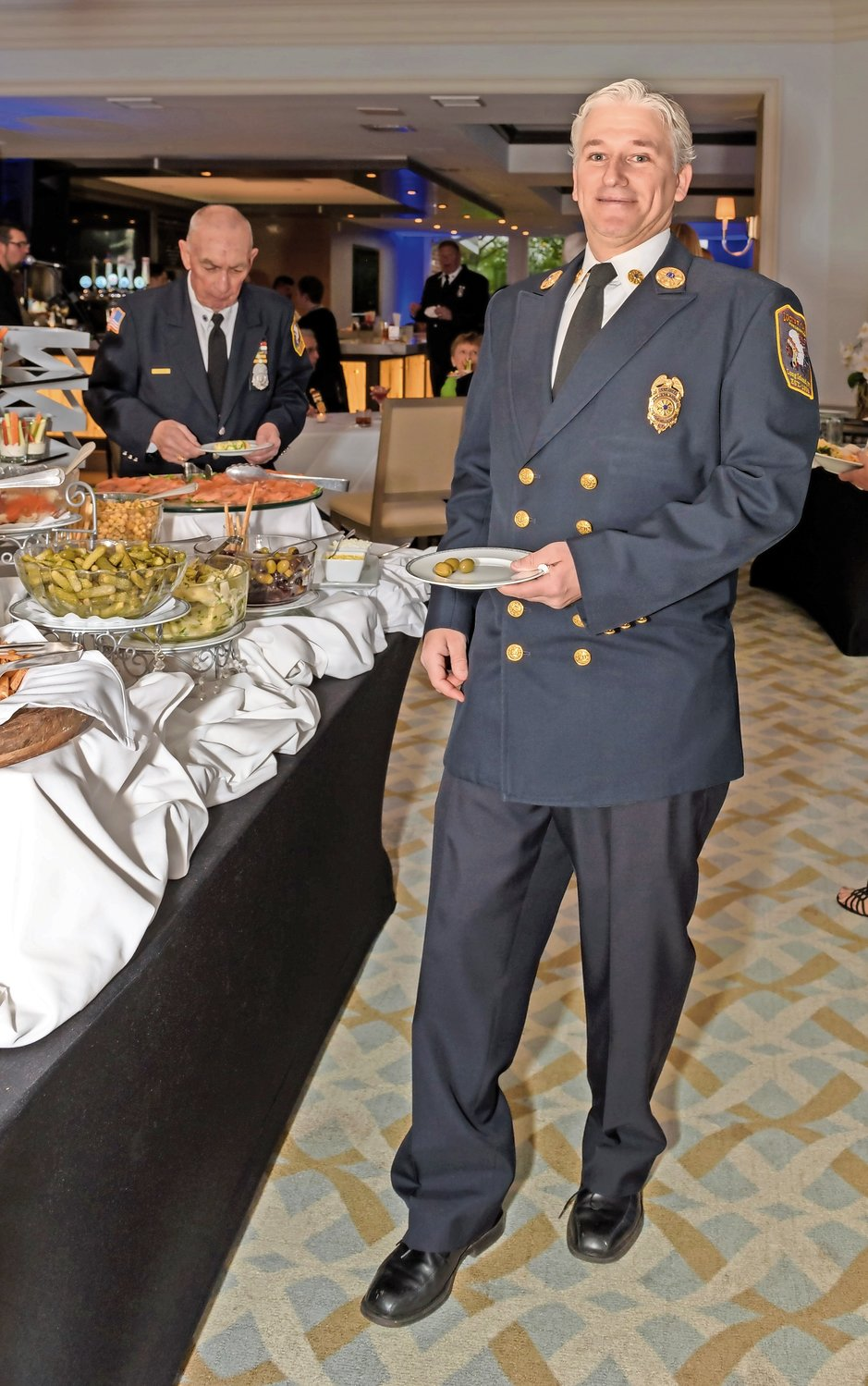 Ex-Chief Peter Greenfield enjoyed the delectable food served at the buffet.