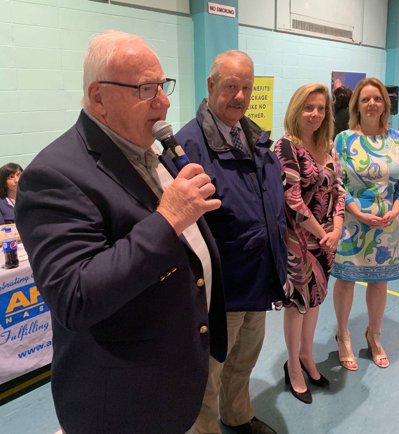 Senator John Brooks, left, hosted the annual Job and Career Fair at the Freeport Recreation Center with the support of Freeport's Mayor Robert Kennedy, second from left, and is attended by a number of other elected officials like Laura Gillen, Town of Hempstead Supervisor, third from left, and Nassau County Legislator Debra Mulé, right.