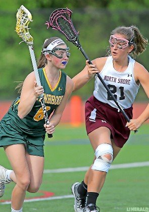 Lynbrook's Felicia Guglielmo, left, turned upfield against North Shore's Olivia Schatz during a Nassau Class C quarterfinal playoff game May 16.
