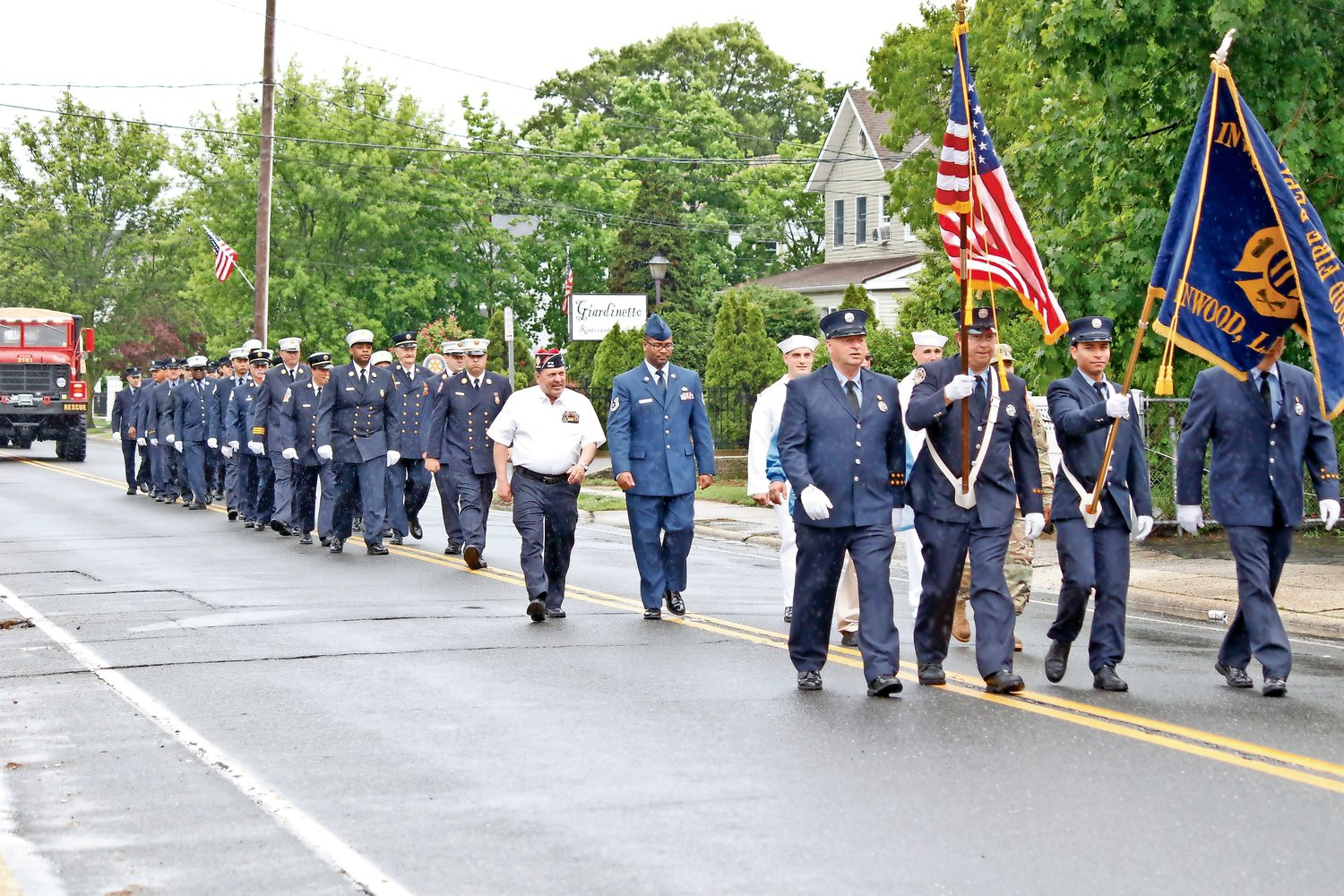 Last year's Inwood Memorial Day Parade was led by the Inwood Fire Department's Color Guard. From left were from left, Royal Pearsall, Richard Perone, John Romero and Kenneth Oehler III.
