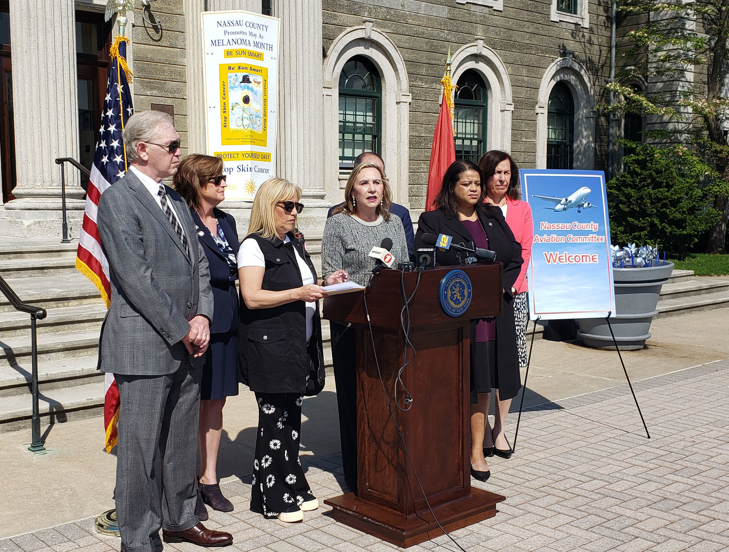 Malvernite Elaine Miller, a co-founder of the newly formed Nassau County Aviation Committee, at lectern, spoke about the negative impact of jet noise at a news conference on May 17.