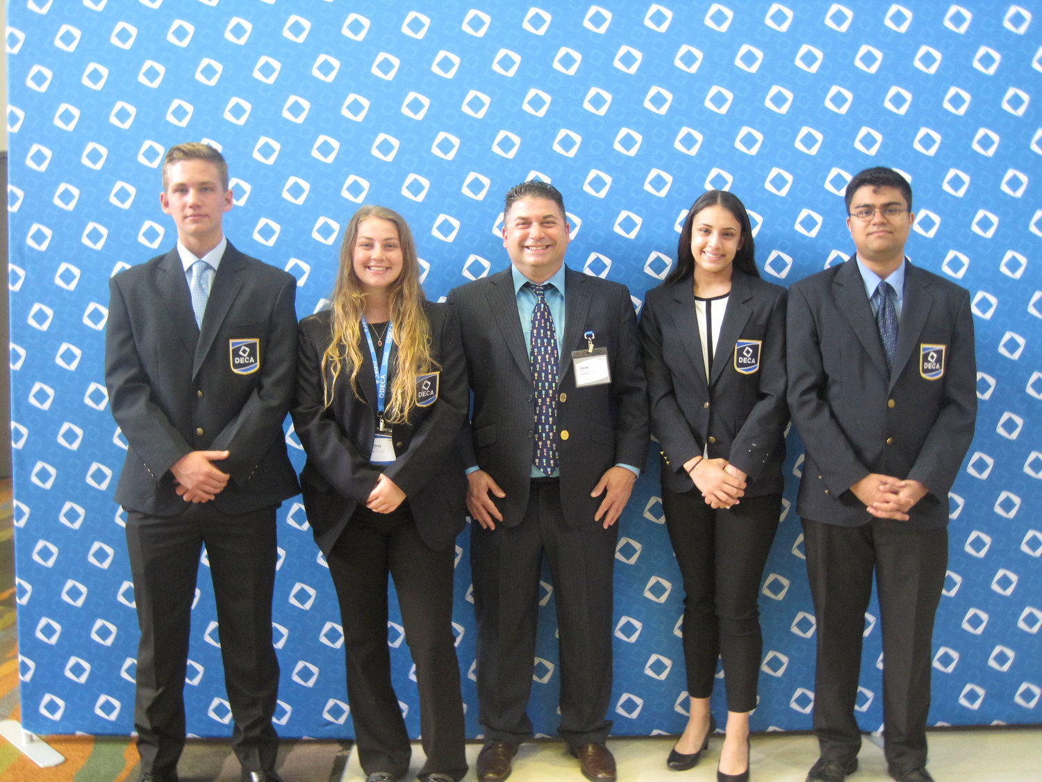 Orlando, Fla. Hosted the international DECA competition where four Lawrence High students competed. From left were Luke Kirchner, Brook Kirchner, club adviser Mark Albin, Danielle Hance and Amil Virani.