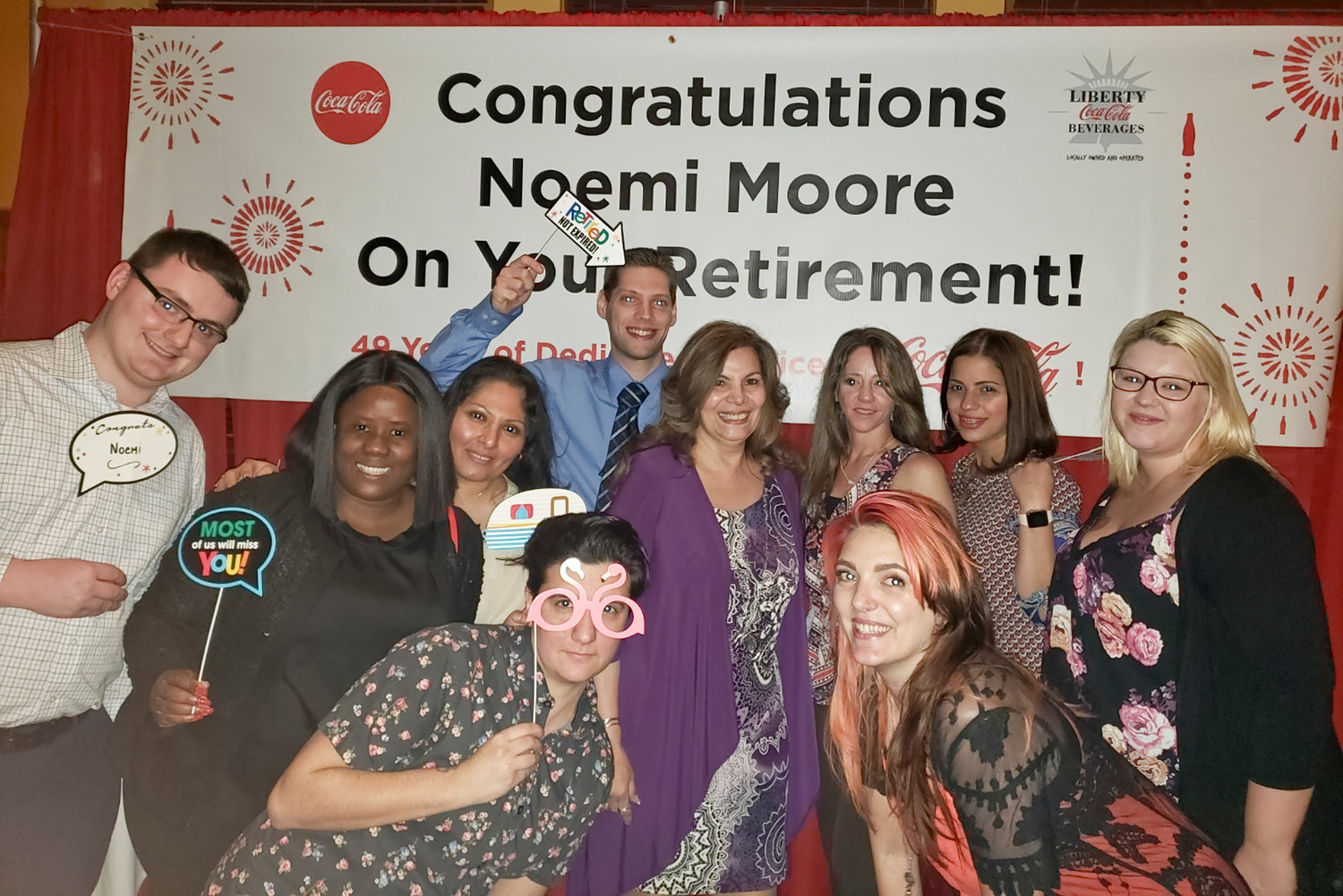 Noemi Moore, center, with her co-workers and team celebrating her retirement after nearly 50 years at Coca-Cola.