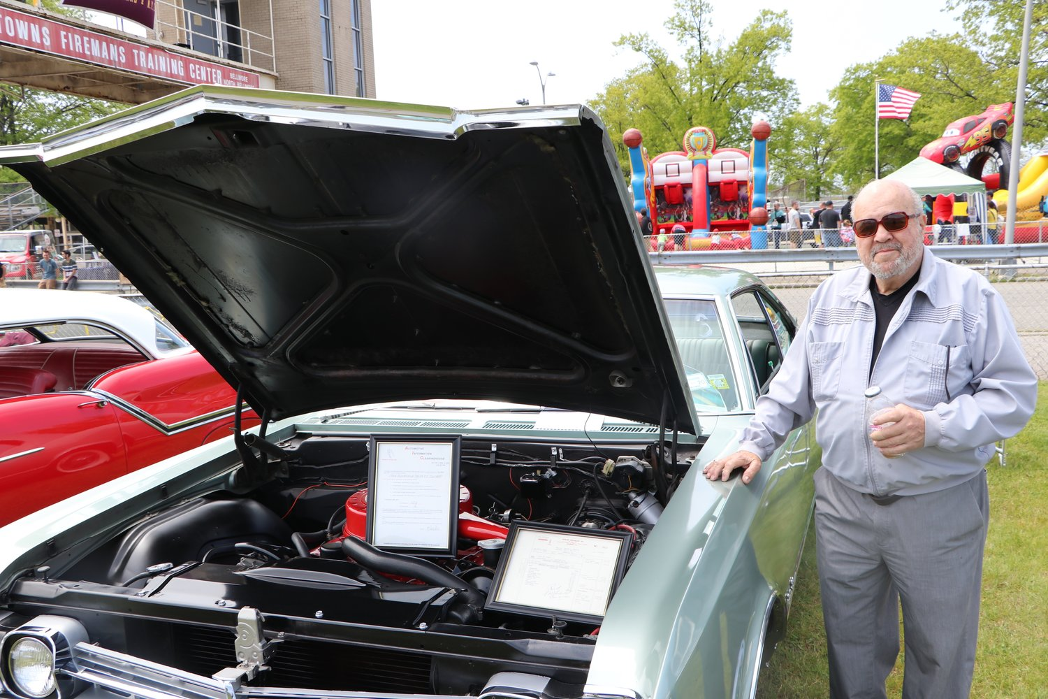 Carmine Petrasini, of East Meadow, shows off his 1966 Oldsmobile Delta 88.