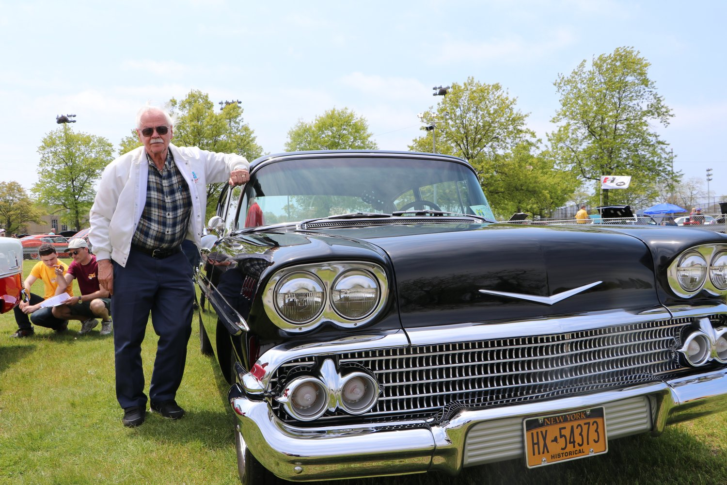 Merokean John Brokos with his 1958 Chevy Biscayne Sports Coupe