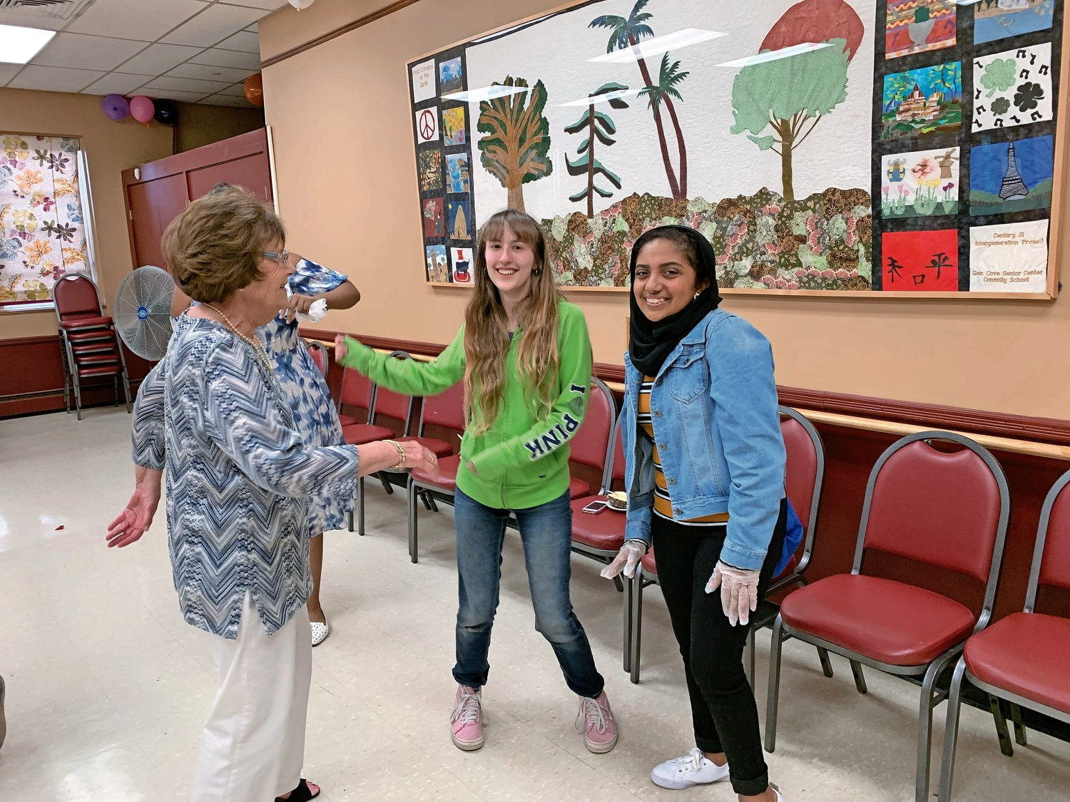 Shirley Skeldon, 78, broke away from the other seniors to dance with sophomores Angelina Holden, 16, and Jasmyn Fakhry, 15.
