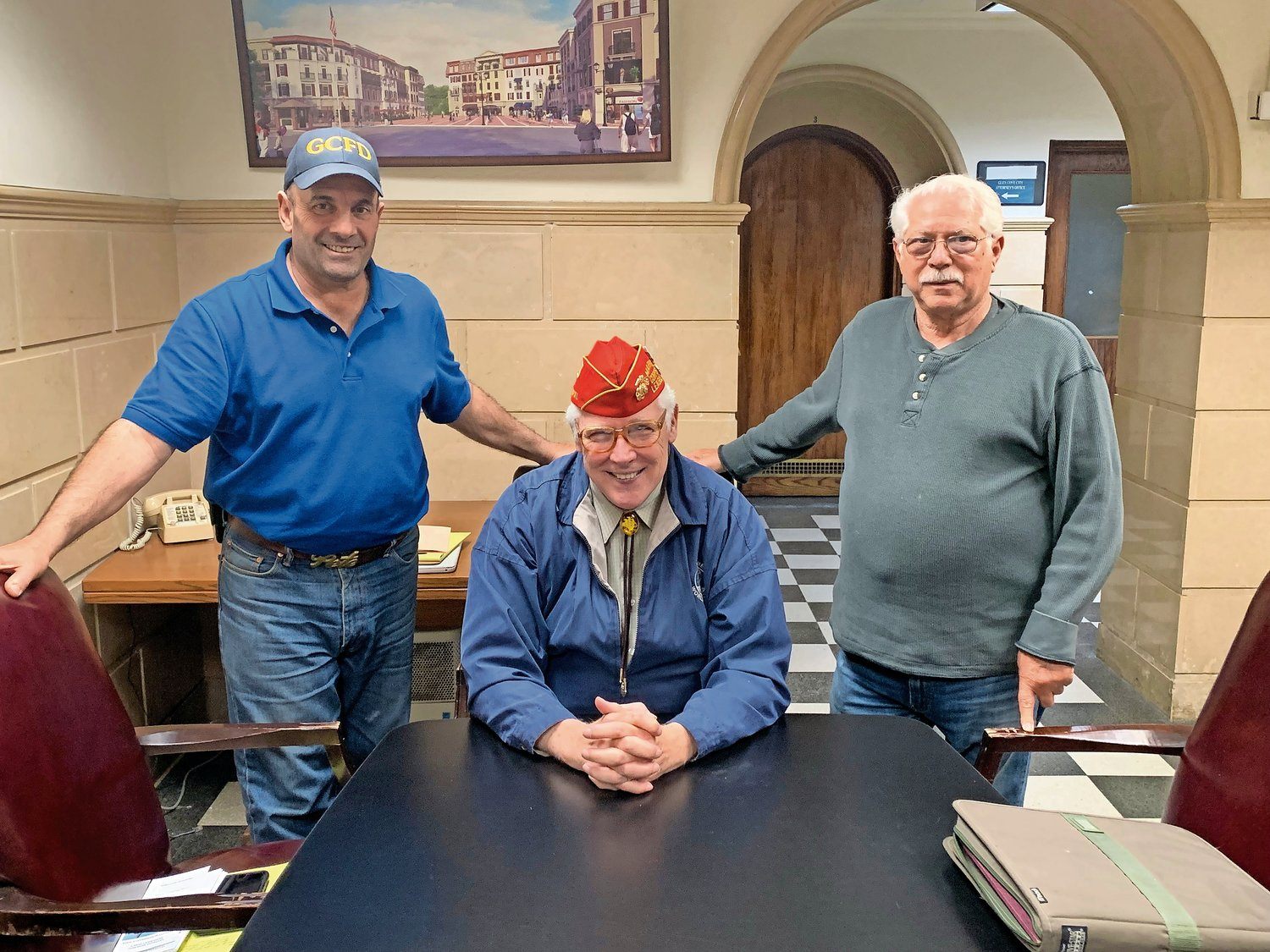 Fred Nielsen, center, the Memorial Day Parade Committee chairman, led a unanimous vote to bring the Road Panthers back into the Memorial Day parade, thanks in part to the advocacy of Road Panther and parade committee member Pete Prudente, left, and Tony Contorino, the Road Panther president.