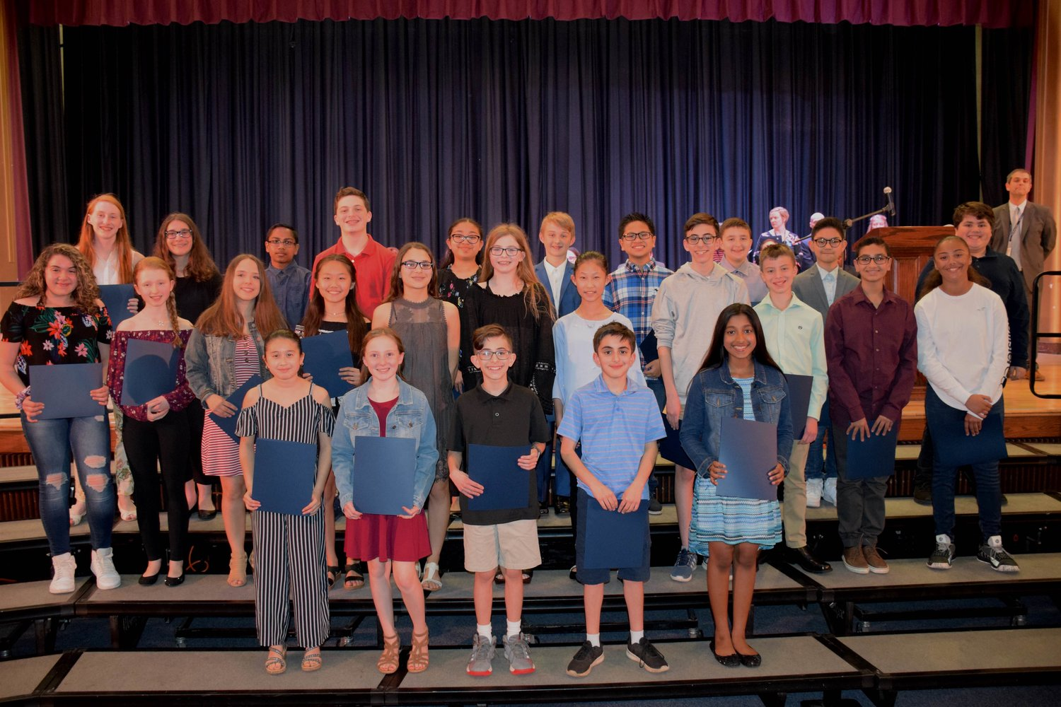 Students from W.T. Clarke Middle School and Woodland Middle School were honored for their musical talents at the East Meadow School District's Music and Art Award ceremony on May 7.