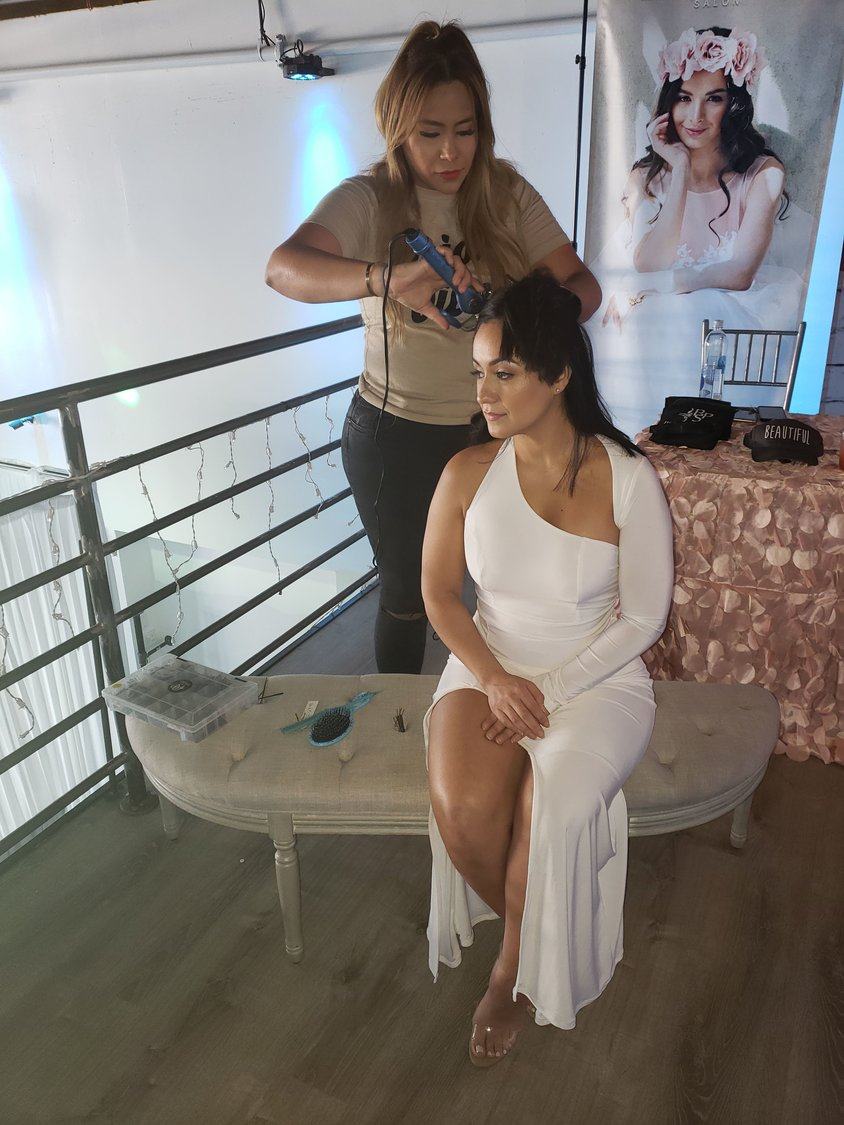 Owner of Beautiful People Salon in Merrick, Judy Abreu styled one of the bridal dress model's — Diane Arias, 35, from Freeport, hair during Abride's Wedding Showcase at the Factory in Freeport on May 19.