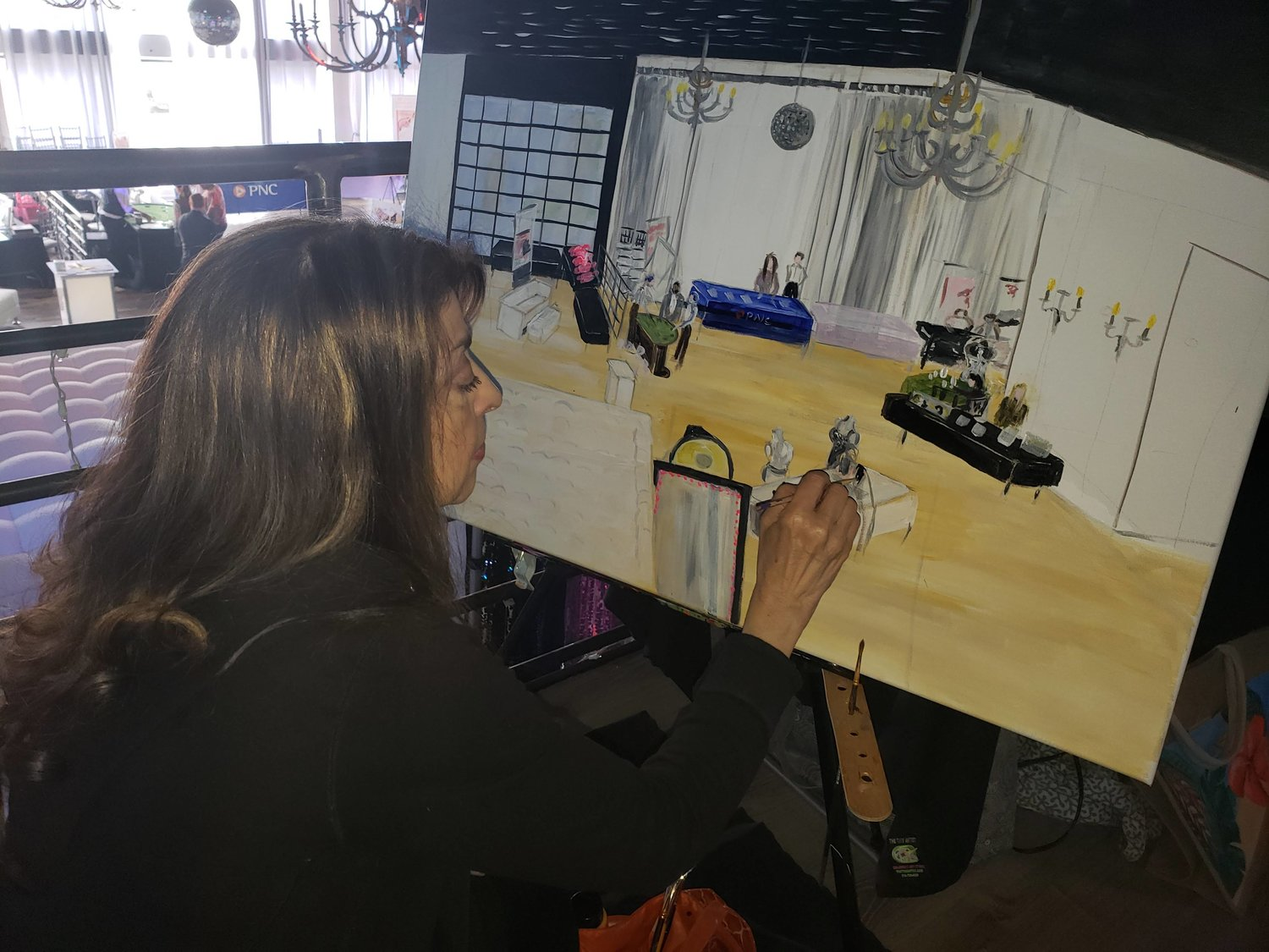 During the bridal expo, The Tiny Artist owner, Isabelle Rapacciulo painted a portrait of the event as it was happening.