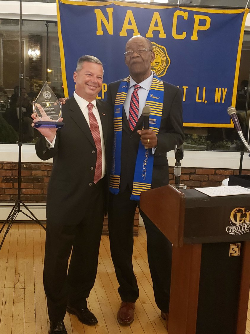 Freeport Housing Authority director, John Hrvatin, left, received the National Association for the Advancement of Colored People, NAACP, 2019 Community Service Award. President of the NAACP, Douglas Mayers presented Hrvatin with his award.