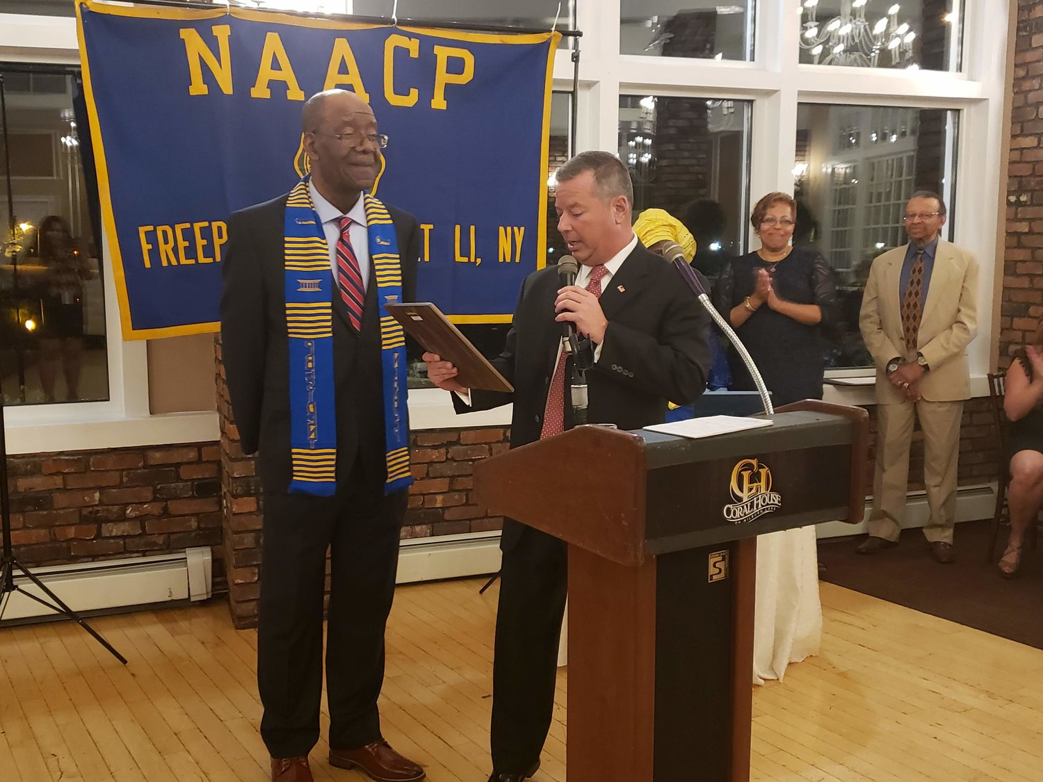 After the president of the NAACP, Douglas Mayers, left, presented John Hrvatin, the director of the Freeport Housing Authority, FHA, with his award; Hrvatin surprised Mayers with a plaque of recognition for his service and support to the village of Freeport and the FHA.