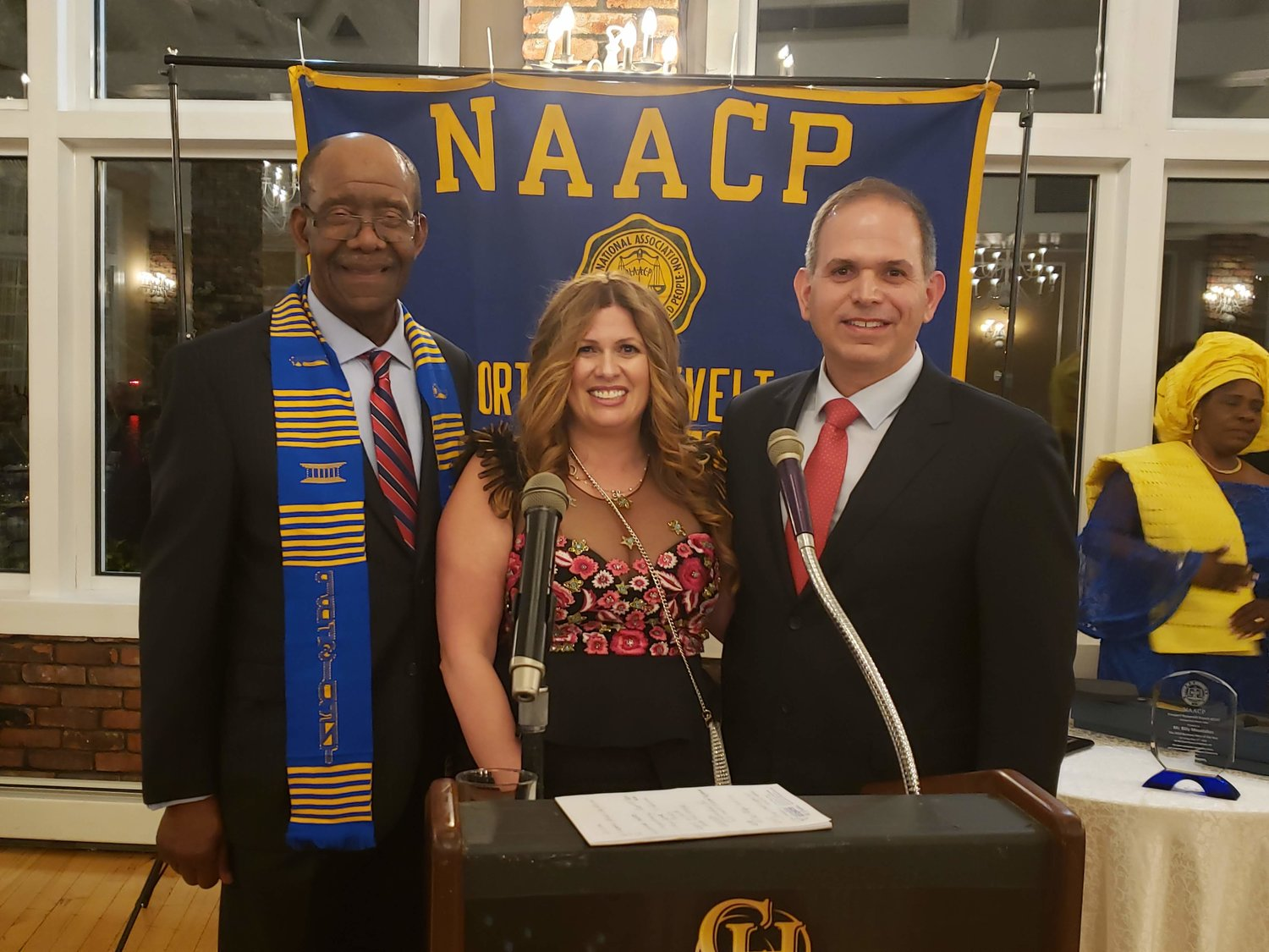 Imperial Diner owners — brother, Bill Moustakas, right, and sister Lana Moustakas Manetto, center, were awarded as the 2019 Business Award from the NAACP and presented with their award by president Douglas Mayers, left.