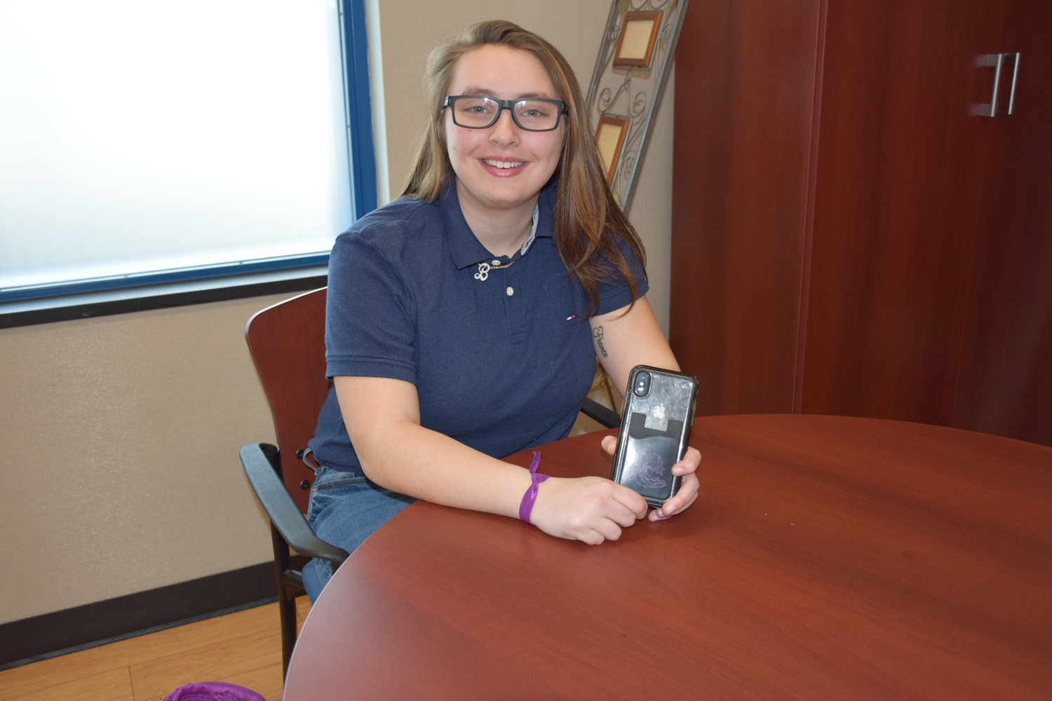 Long Beach High School junior Brooke Yellin sold bracelets and phone wallets, like those pictured, to raise money for a scholarship foundation in honor of her late mother, Geri Yellin.