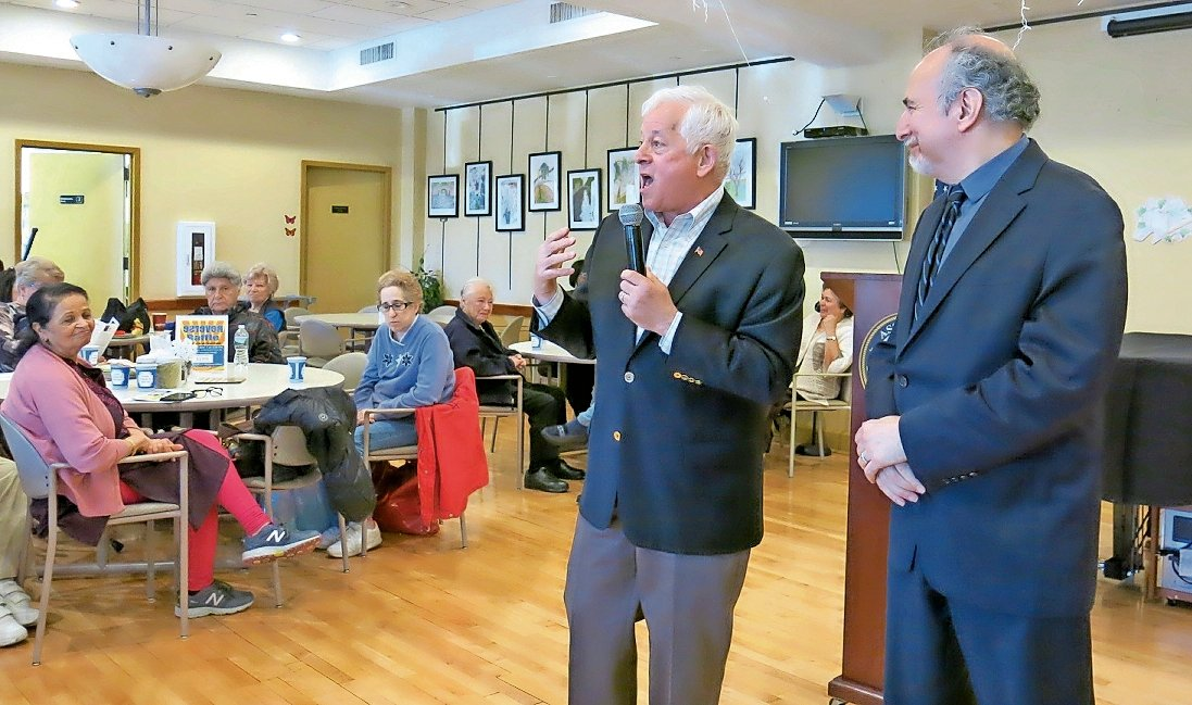 State Assemblyman Chuck Lavine, left, and Adam Levin, a representative of New York State Attorney General Letitia James's office, shared information on the latest scams with seniors at the Life Enrichment Center in Oyster Bay.