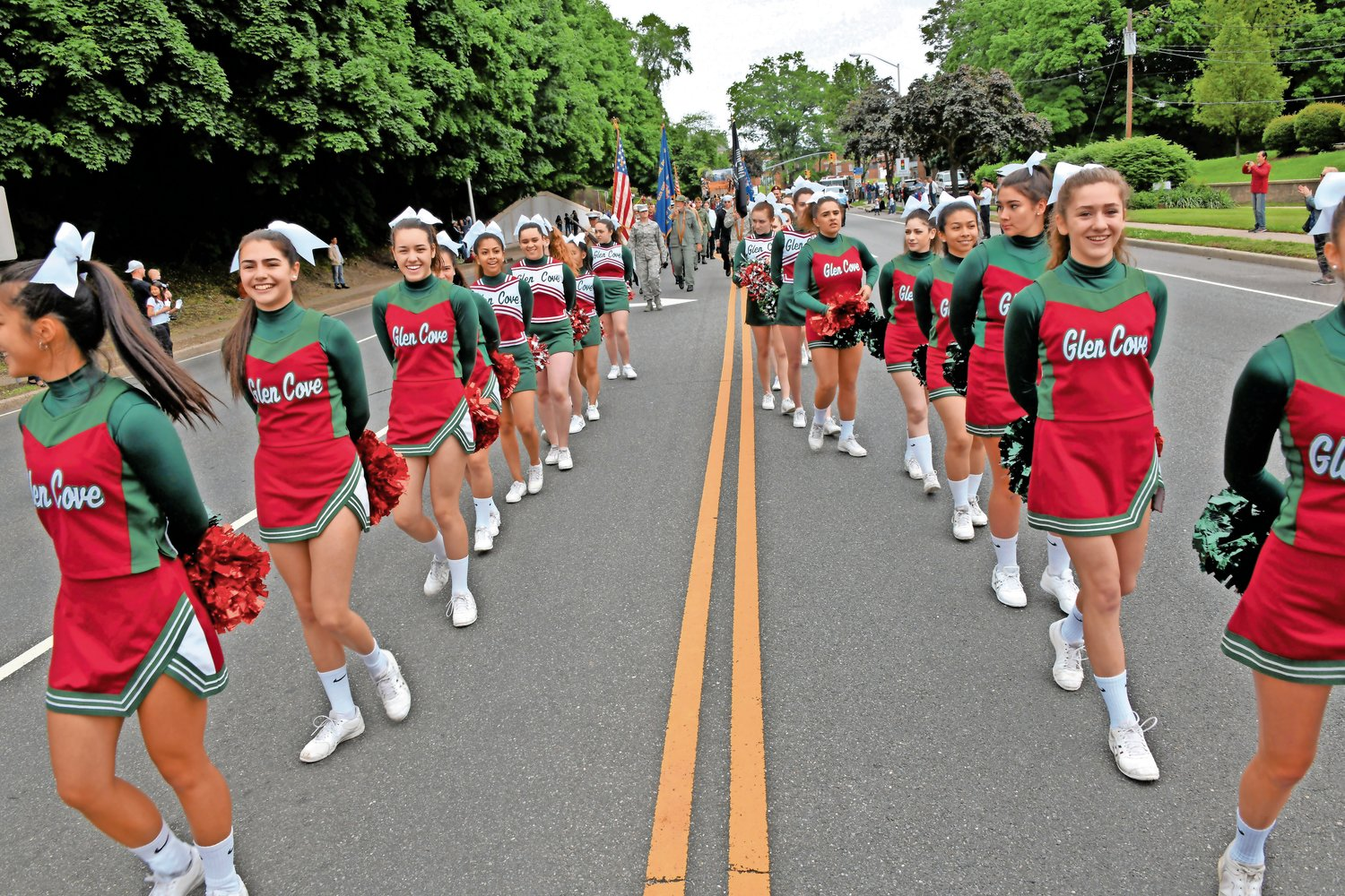 Cheerleaders from Glen Cove schools kept the parade route lively for Memorial Day.