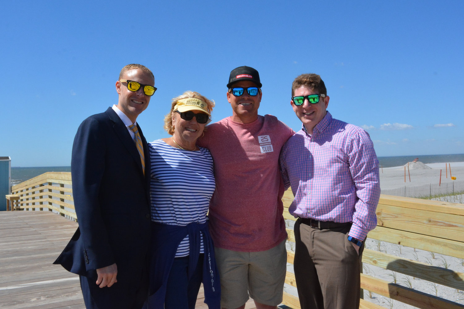 Acting City Manager Rob Asgostisi, left; Carol O'Neill, organizer of the annual Michelle O'Neill Volleyball Tournament; Skudin Surf's Cliff Skudin; and city spokesman Gordon Tepper at Friday's ceremony.