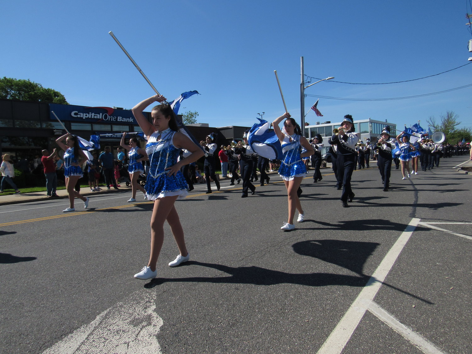 The Hewlett High School marching band performed as the holiday parade proceeded up Broadway.