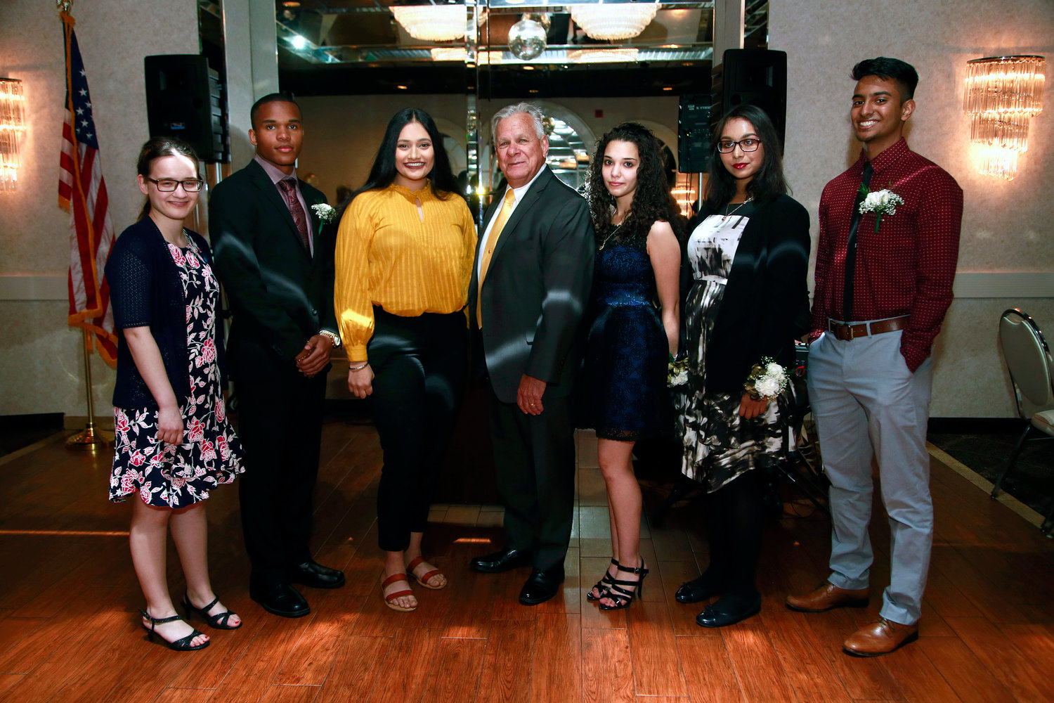 West Hempstead Community Scholarship Fund President Tom Kemnitzer, center, honored scholarship recipients Mary Penson, far left, Cameron Phillips, Harpinder Kaur, Aya Zubi, third from right, Somaia Saba and Neven Vaduthala on May 14.