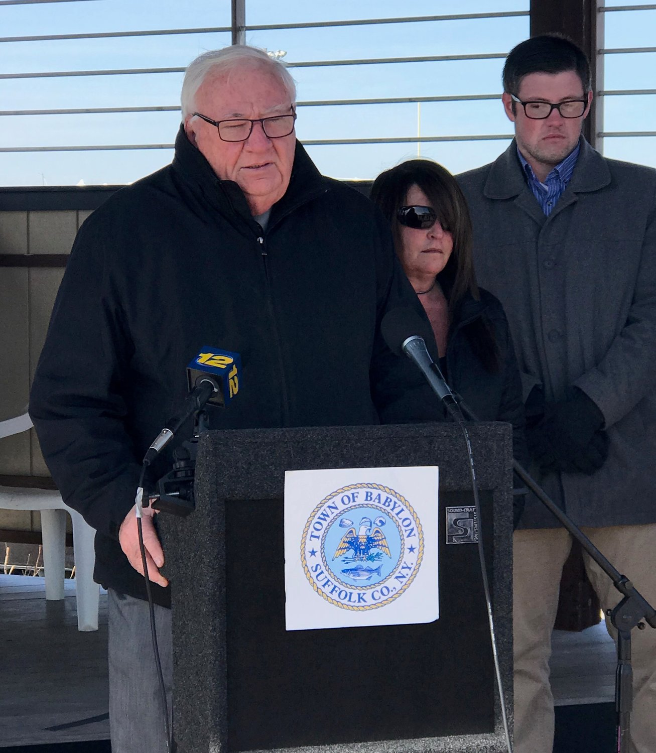 Senator John Brooks, at the lectern, announced the passing of Brianna's Law, bill S.5685 that requires boaters to take safety boating courses and exams to operate vessels on navigable waters.
