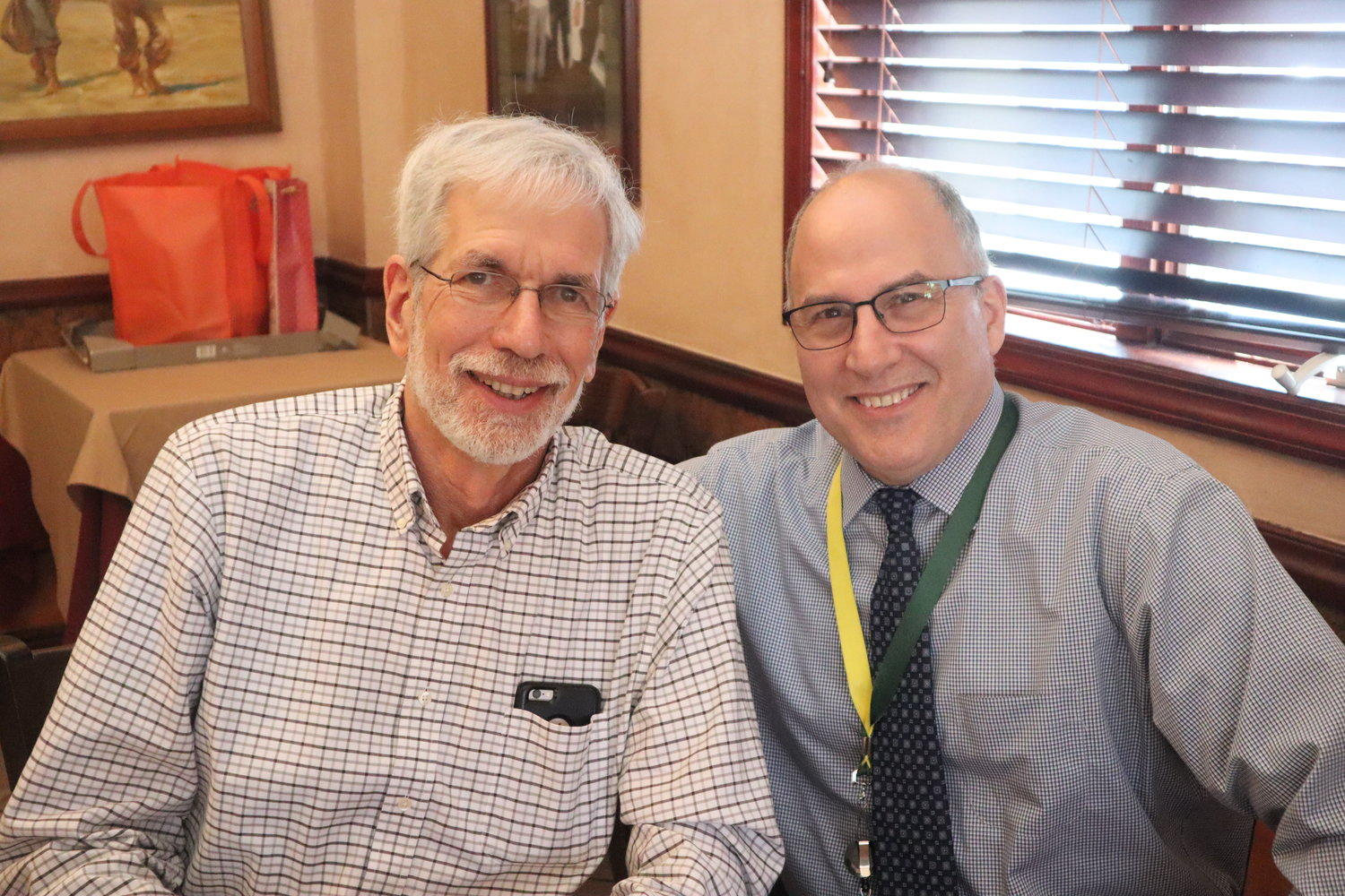 Mike Dolber, left, and Mark Steinberg attended the Bellmore-Merrick Retired Teachers Association's 35-year anniversary dinner on May 22.