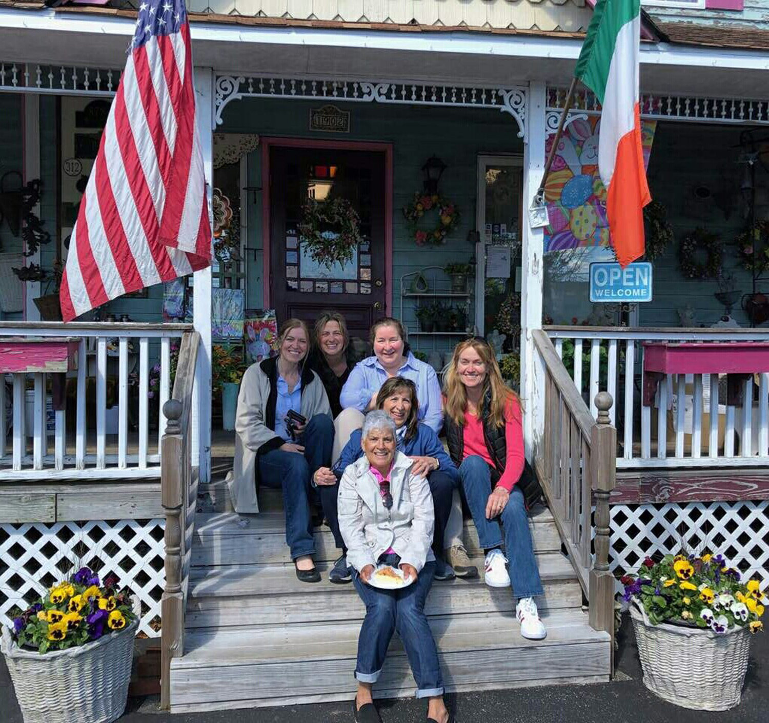 Owners Ann Durkin, far left, and Ellen Dolan, in pink, stock the shop with their favorite items from home.