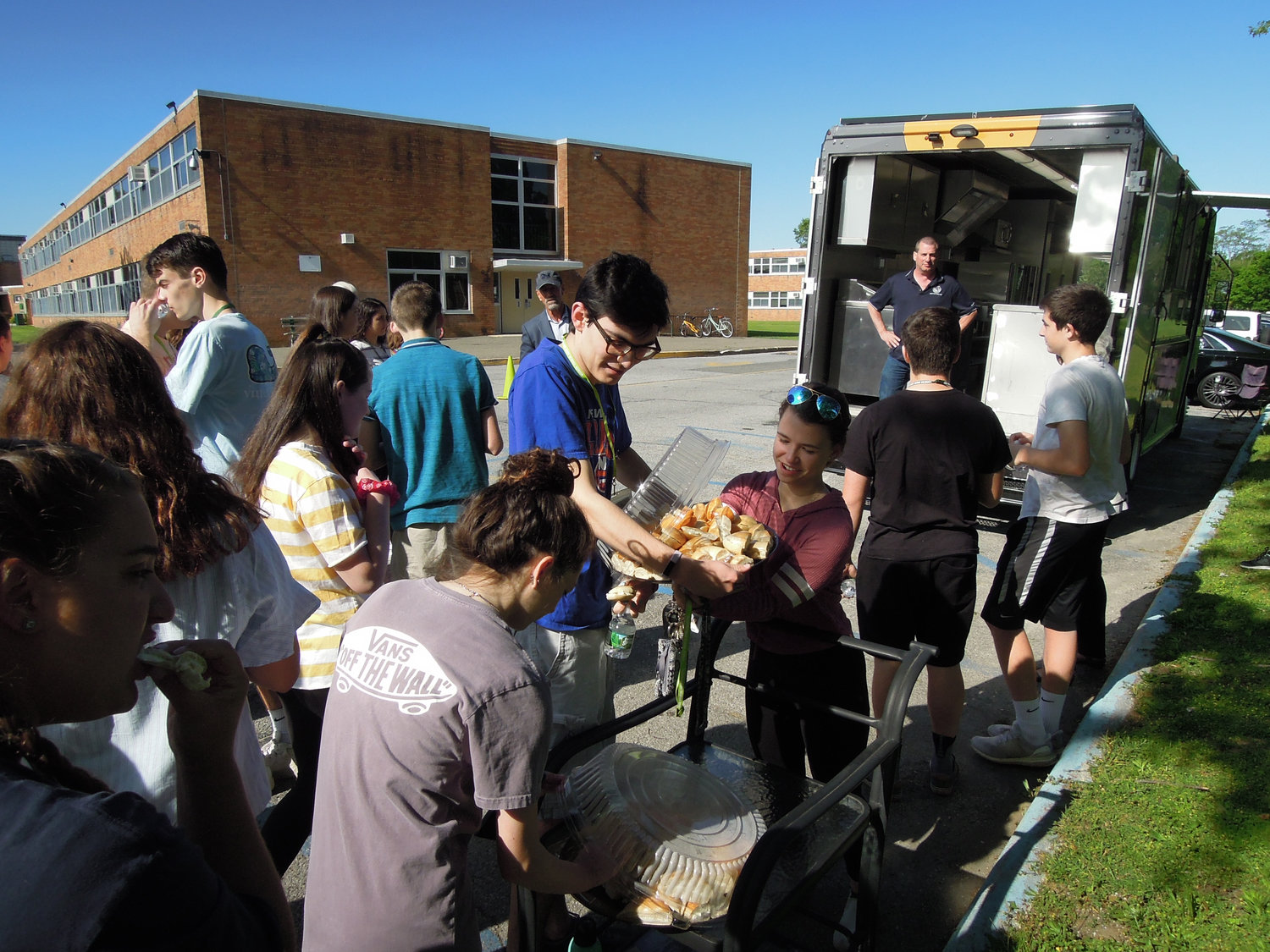 Seaford High School students helped themselves to bagels and beverages as Robbins looked on.
