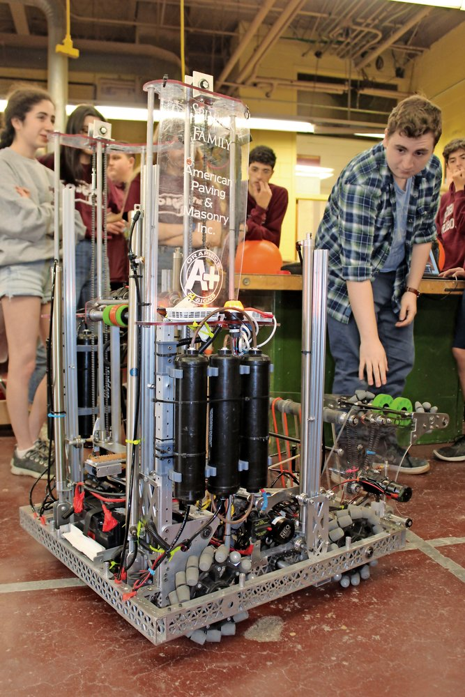 Junior James Coutsoukes prepped the robot, Fran, for action.