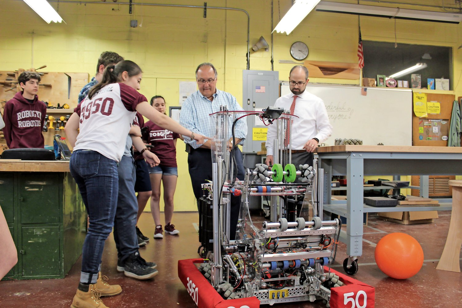 Leventhal, left, showed Montesano and Ra the different parts if the robot.