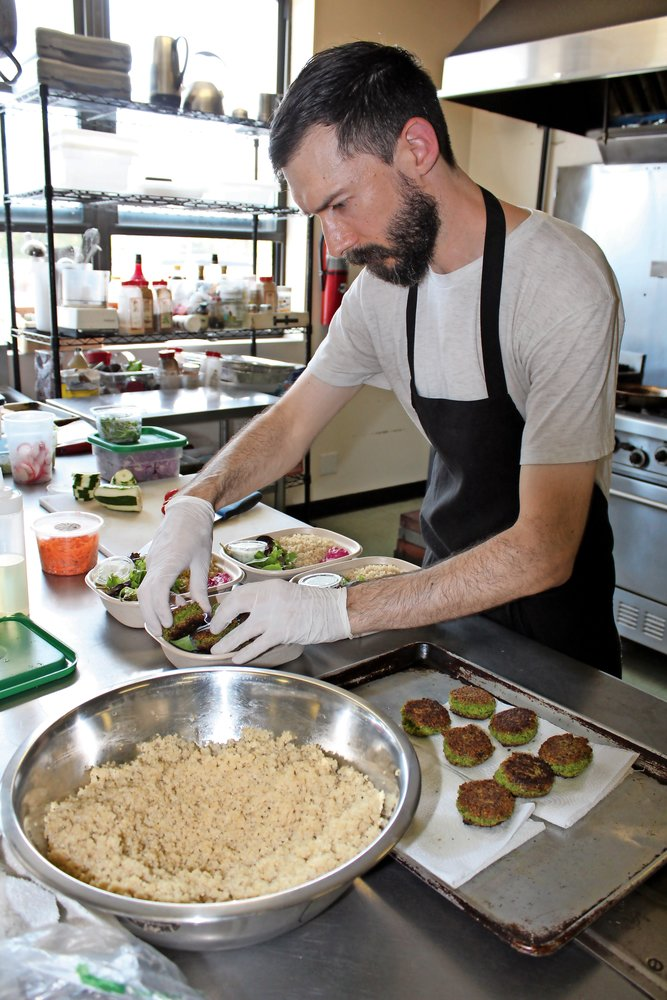 Michael Schoudel plated his falafel platters with care.