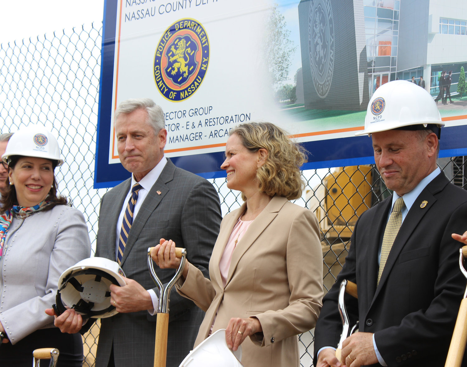 District Attorney Madeline Singas, left, Presiding Officer Richard Nicolello, County Executive Laura Curran and Police Commissioner Patrick Ryder dug shovels in the ground to symbolize the construction of the new facility.