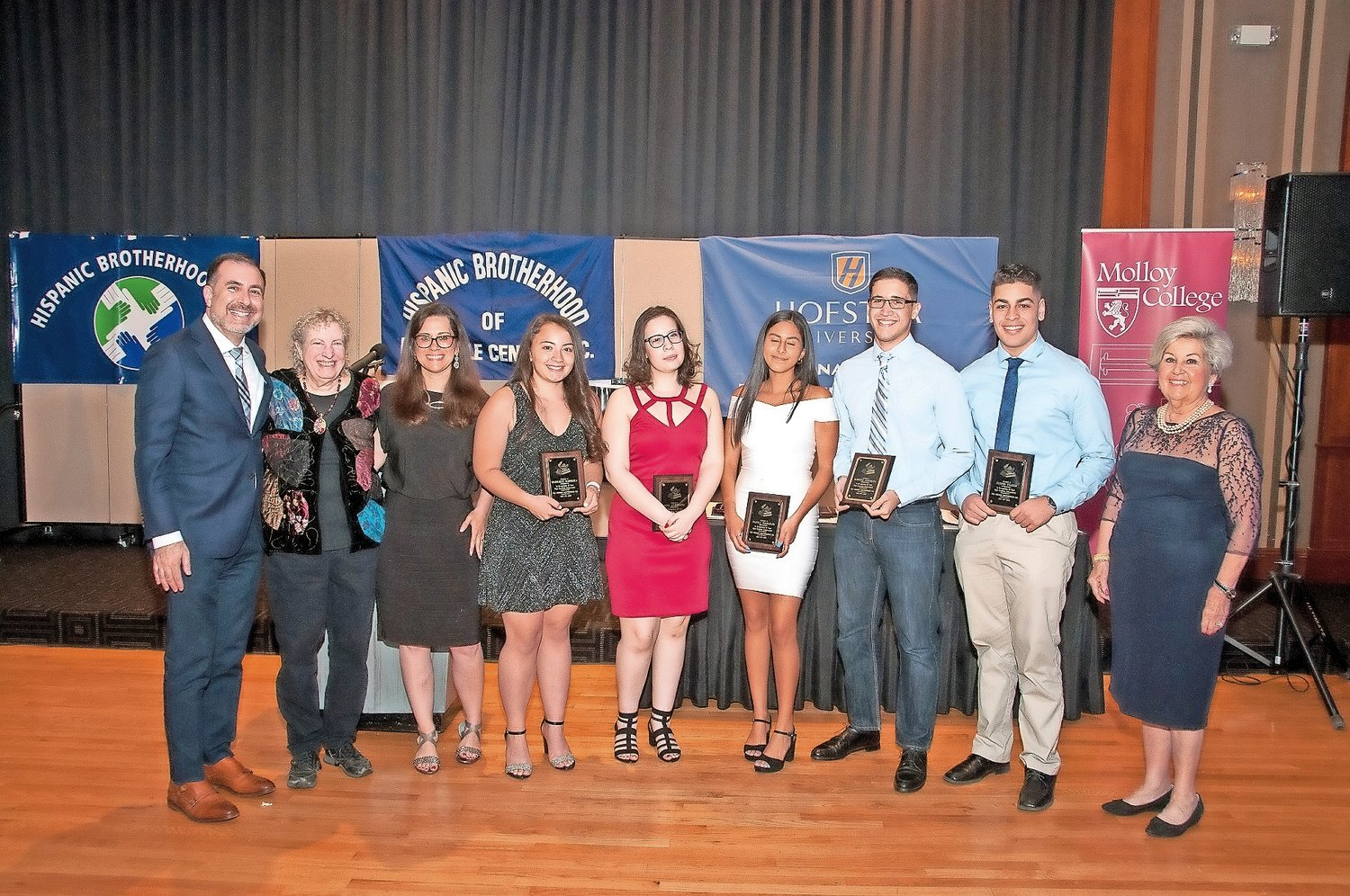 The scholarship recipients, Margaret Barreira, fourth from left, Ana Avendano, Paula Naranjo, Robert Peralta and Justin Fiallo, were joined by Dr. David Rose, the Oceanside School District's world, languages and English as a New Language department director, far left; Ellen Grossman, a Hispanic Brotherhood board member; Marguerite Keller, the Brotherhood's co-director; and Margarita Grasing, its executive director.