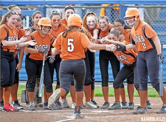 Hunter Vertuccio, No. 5, was greeted at home plate by her East Rockaway teammates after homering in the third inning of last Friday's 1-0 win over Oyster Bay that clinched the Nassau Class B championship.