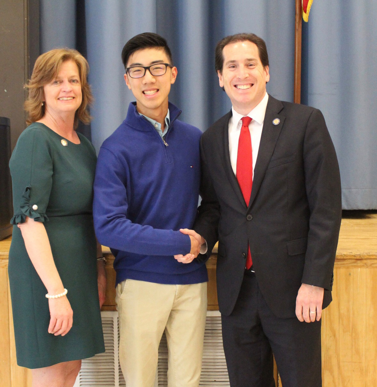 Malverne High School valedictorian Nelson Chow, center, was recognized by State Assemblywoman Judy Griffin and State Sen. Todd Kaminsky for being named as a 2019 U.S. Presidential Scholar.