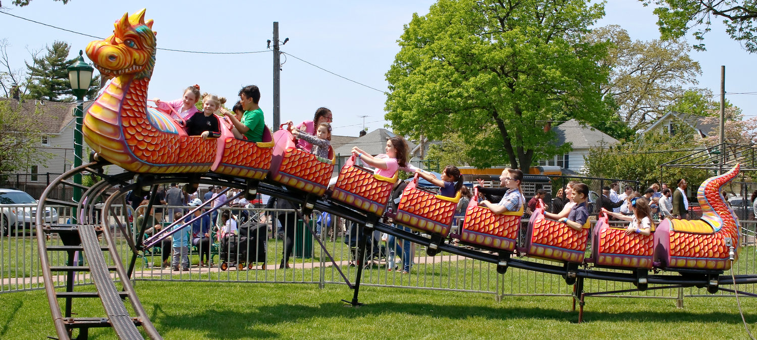 The dragon coaster ride was a popular attraction at the Kulanu Fair in Andrew J. Parise Cedarhurst Park on May 19.