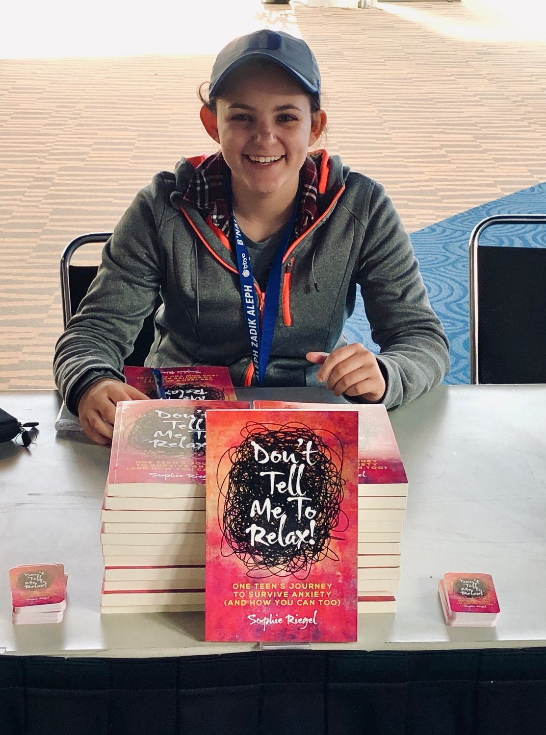 Hewlett High School senior Sophie Riegel signed copies of her book 'Don't Tell Me To Relax,' at the BBYO event in February.