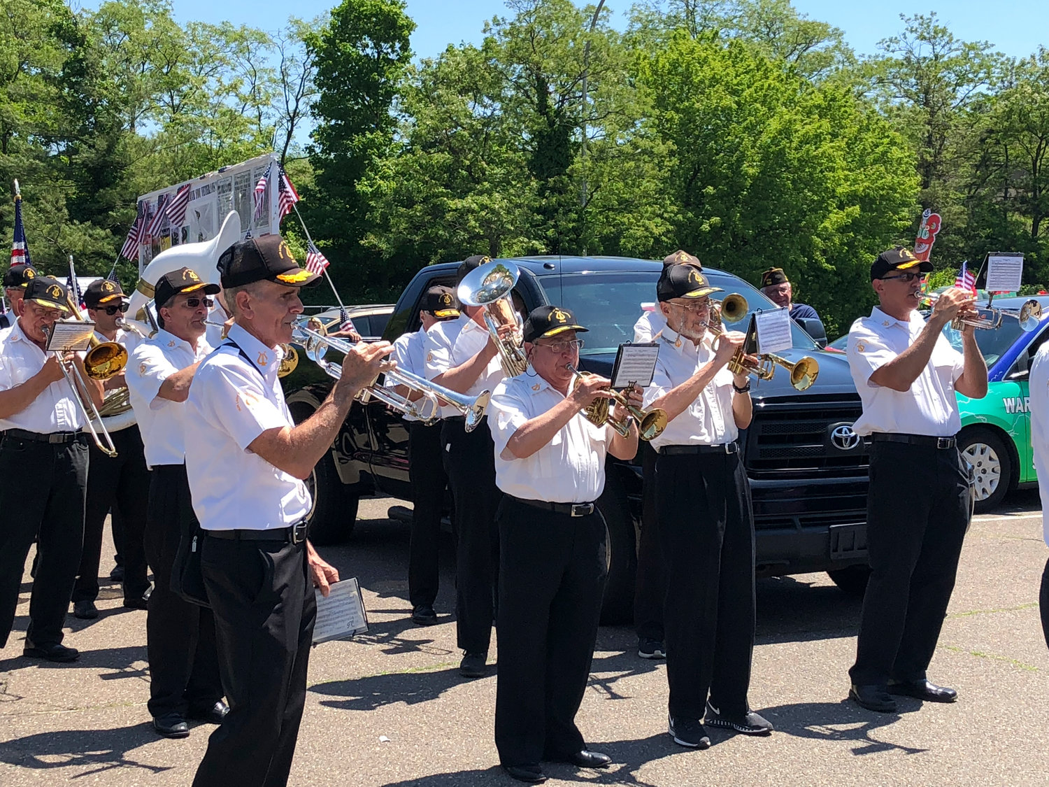 The Our Lady of Good Counsel Band, also known as the Mazza Band, tuned up before marching and performing in the Inwood Memorial Day Parade on May 26.