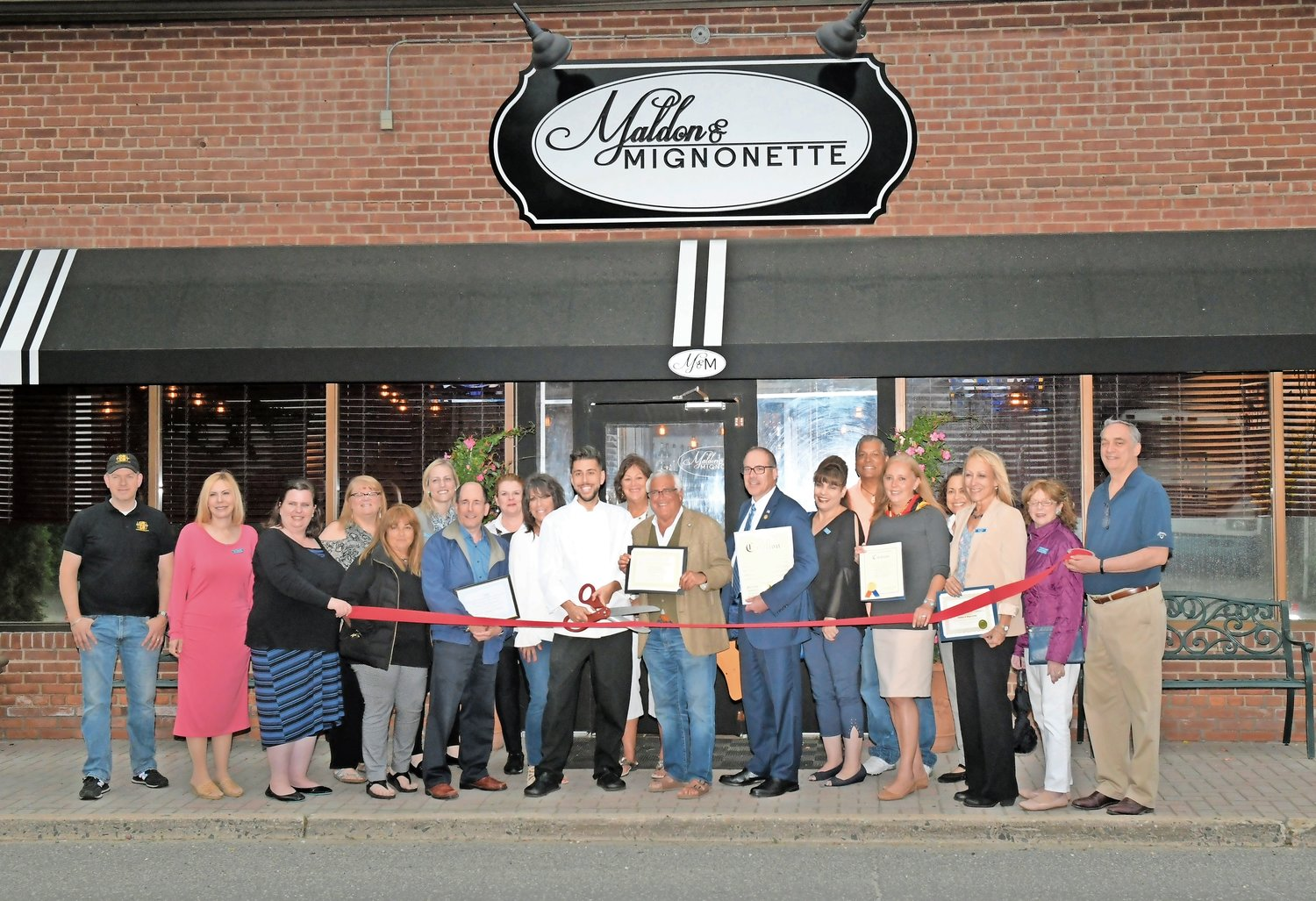 Chef Robert Occhipinti was surrounded by dignitaries, business officials and family members as he cut the ribbon in front of his restaurant, Maldon & Mignonette.