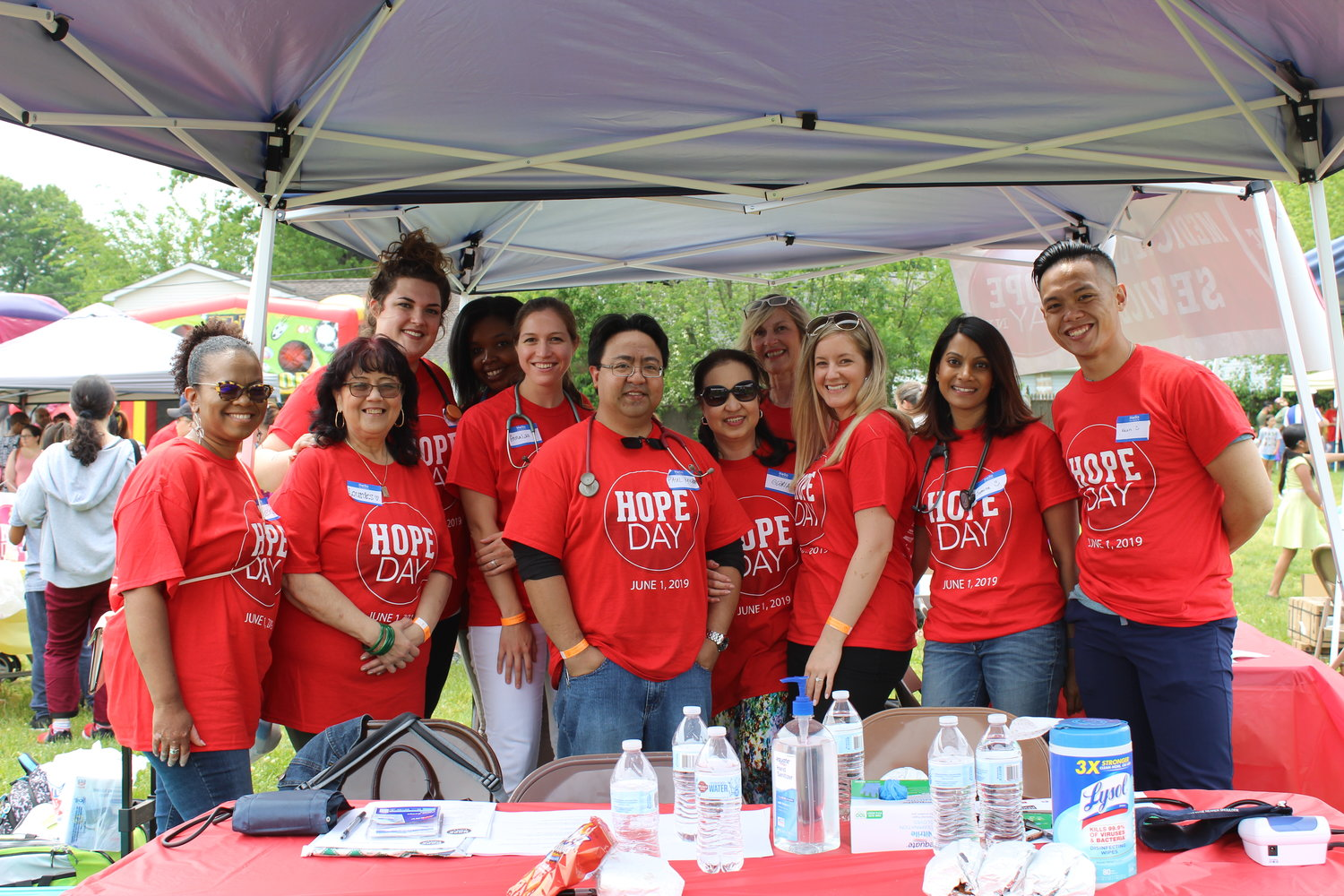 New Hope Church and Shelter Rock Church, both in Westbury, held their annual Hope Day summer extravaganza on June 1. Above is a group of volunteers from the festival's medical and health services booth.