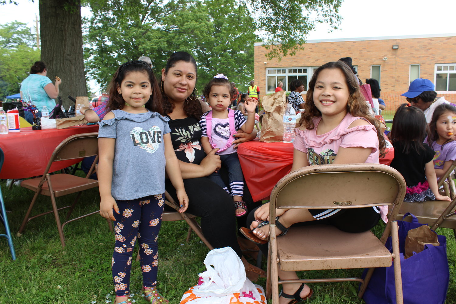 DaMary Ruiz, second-from-left, watched live music with her children Carolina, 5, Carmen, 1, and Genesis, 9.