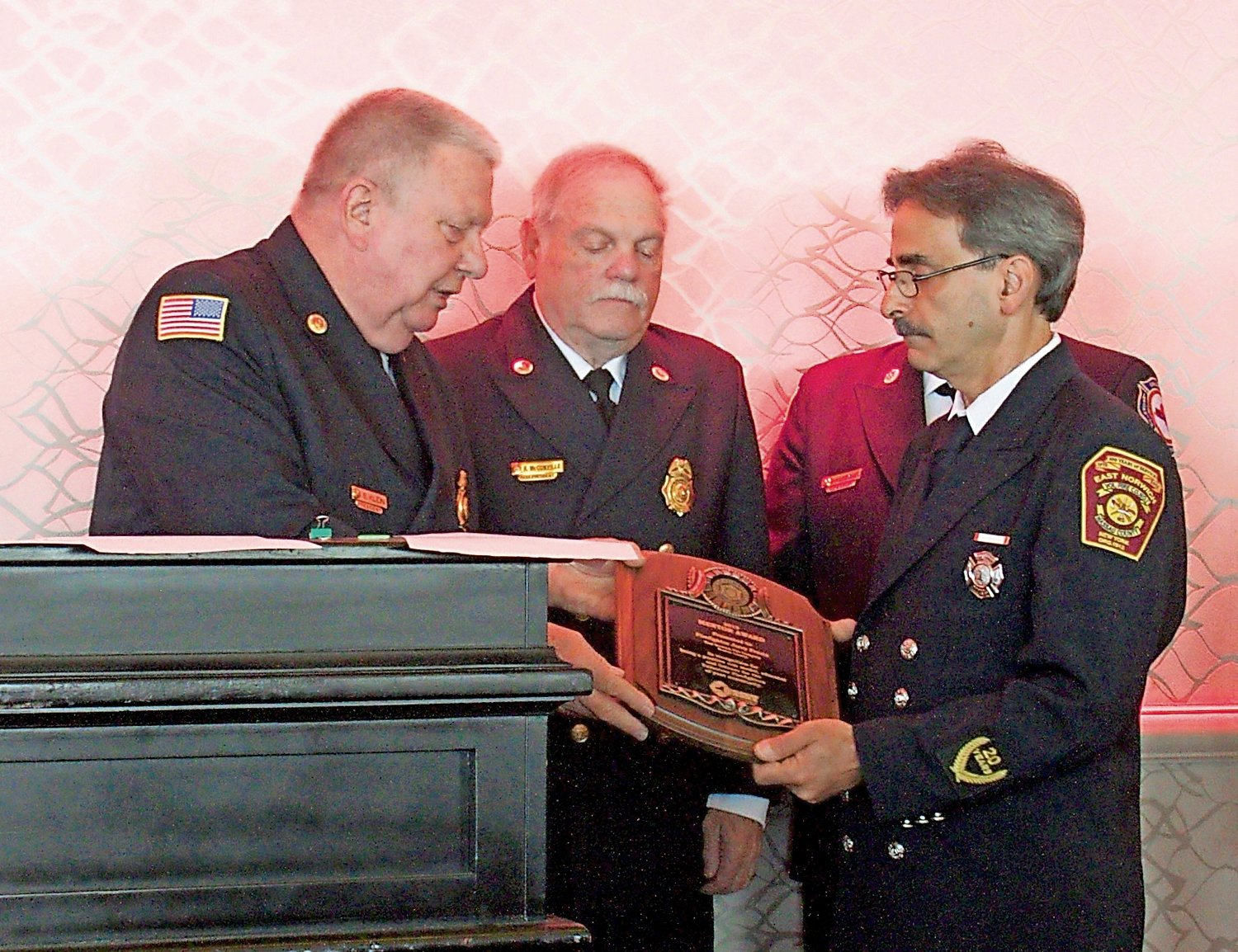 Steven Klein, far left, president of the Firemen's Association of the State of New York, presented Gerard Presta with the Youth Mentor of the Year award as former association President Bob McConville looked on.