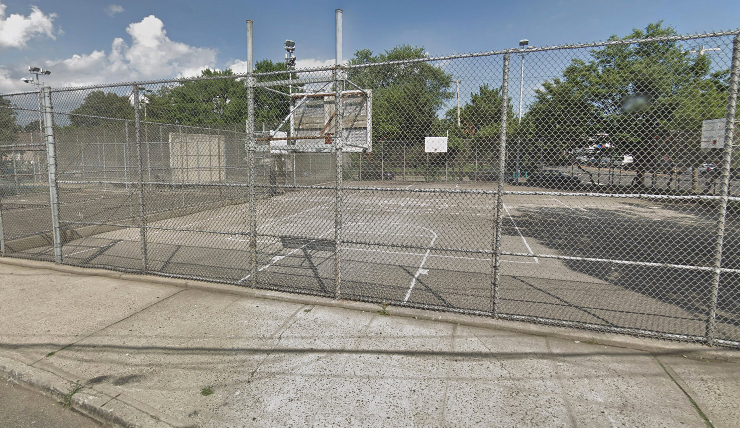 Hendrickson Avenue Park lies on Hempstead Turnpike and provides a modest home for local kids playing basketball.