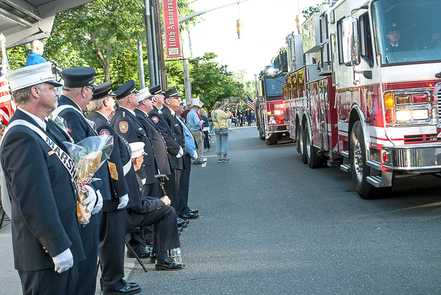 Fire Marshals from a number of fire departments watched as several fire trucks drove down Woodfield Road in Lakeview during the annual 4th Battalion Parade.