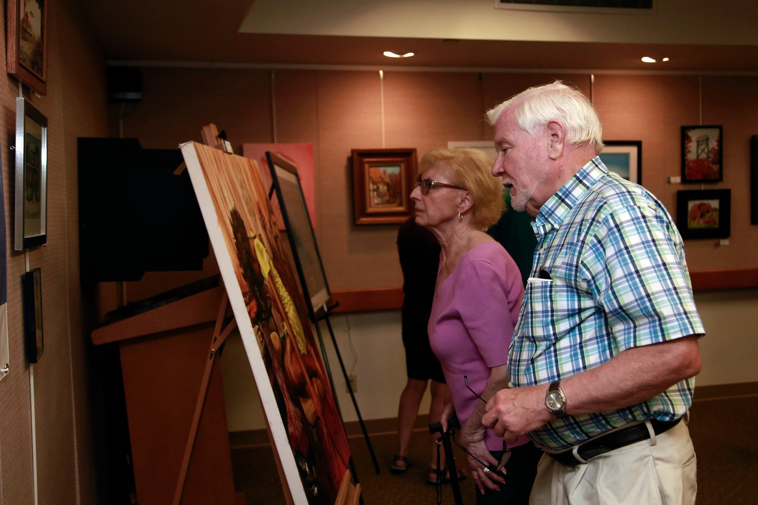 Barbara and Neil Gilmartin checked out some of the artwork at the library.