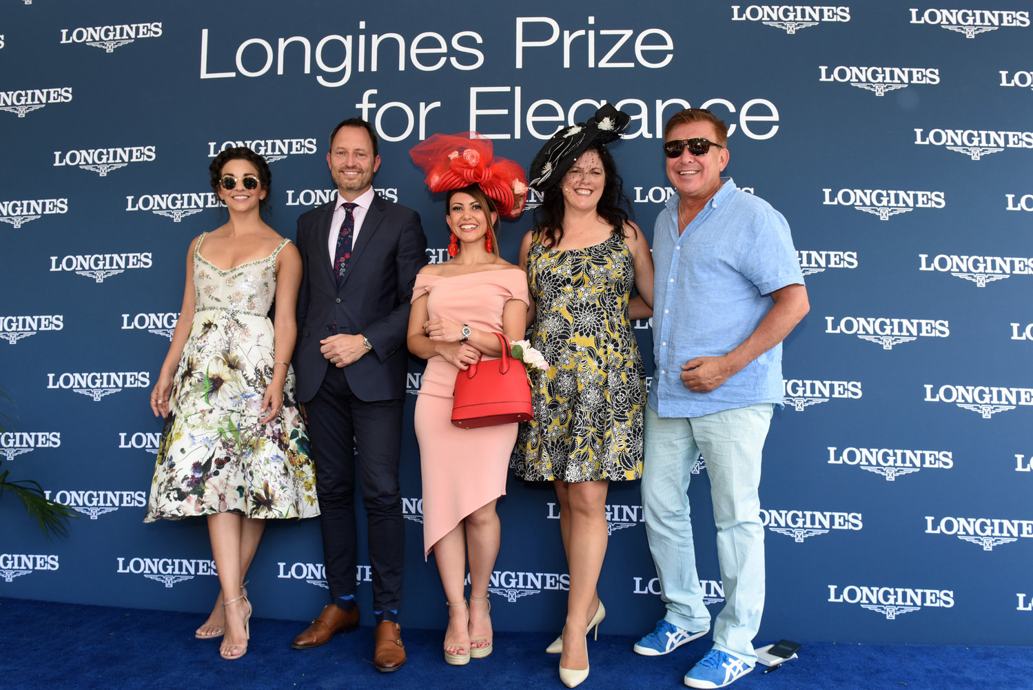 Elham Ayati, center, of New York, celebrates after winning the Longines Prize for Elegance fashion contest, with judges, from left to right, actress Ana Villafane, Pascal Savoy, Longines US Brand President, Christine A. Moore, of Christine A. Moore Millinery, and Forbes fashion editor Joseph DeAcetis.