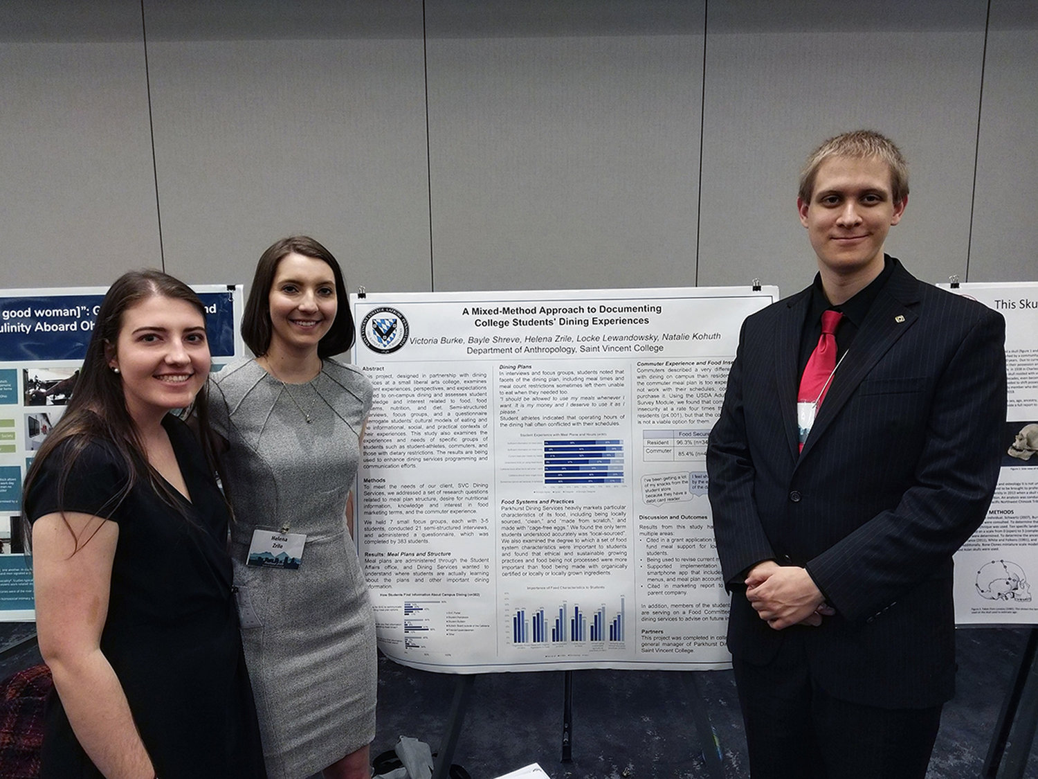 Victoria Burke, from left, Helena Zrile and Locke Lewandosky with one of their two poster boards presented at the Society for Applied Anthropology conference in March.