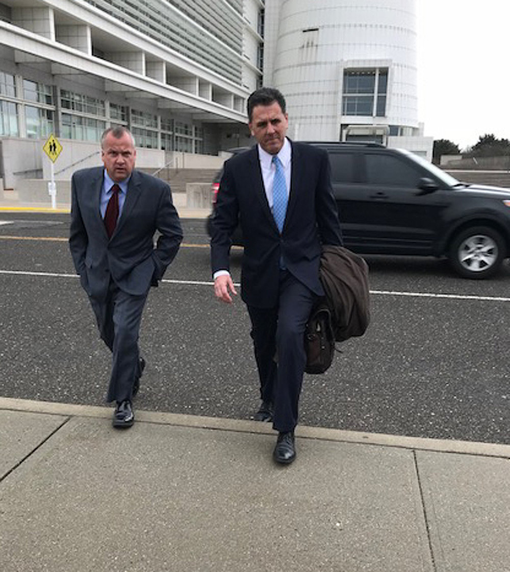 Rob Walker, left, and attorney Brian Griffin, outside Alphonse D'Amato Federal Courthouse in Central Islip in February 2018. Walker accepted a pleas deal last week in exchange for reduced charges.