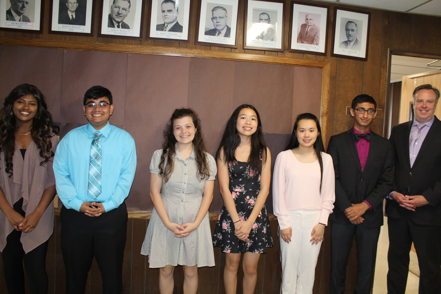 Sophia Steele, far left, Nader Ahmed, Amelia Cossentino, Kailyn Fan, Anne Hwang and Joshua Rajan are the top students in their respective high school senior classes. They were with Superintendent Bill Heidenreich.